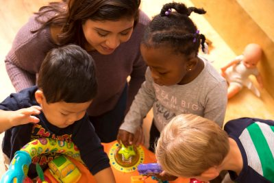 A student in the Virginia Tech Department of Human Development and Family Science provides warm encouragement to young participants in the department's Child Development Center for Learning and Research.