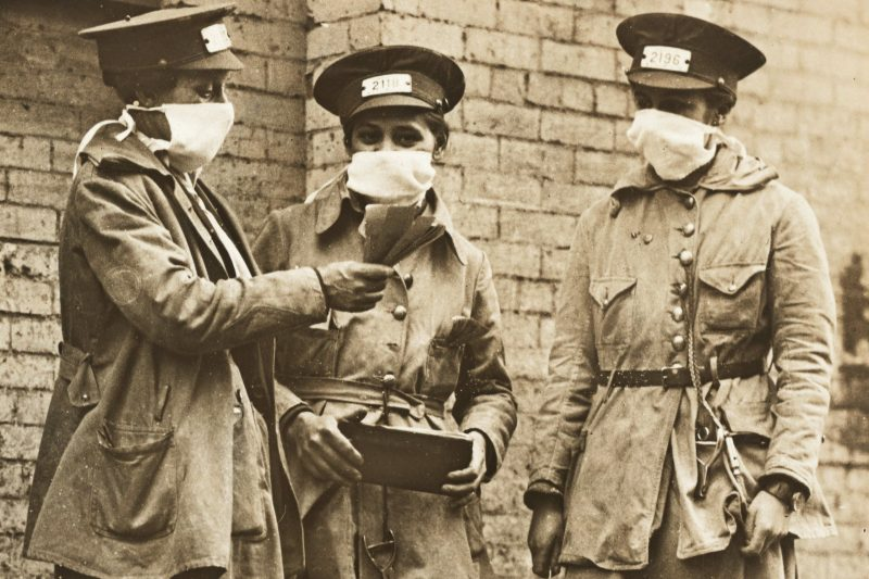 Women conductors in 1918 New York wear face masks to prevent the spread of influenza during the 1918 flu pandemic. National Archives