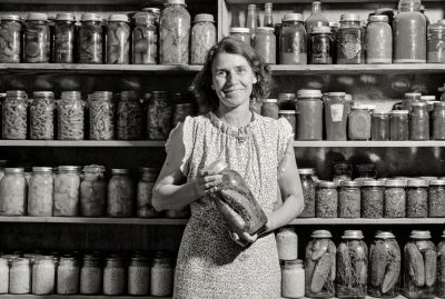 Mrs. H.H. Poland displays her preserved-food pantry in Mesa County, Colorado, in 1939.