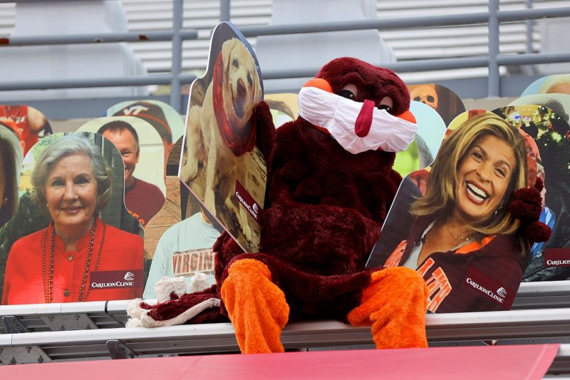 The HokieBird helped place a few cutouts.