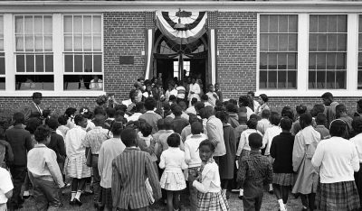 African American schoolchildren entering the Mary E. Branch School at S. Main Street and Griffin Boulevard, Farmville, Prince Edward County, Virginia on September 16, 1963