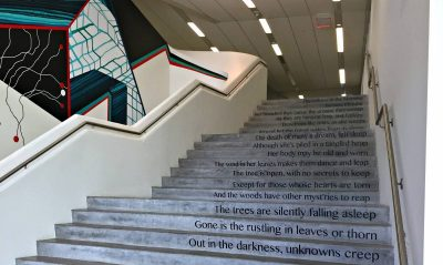 A poem cascades down a Moss Arts Center staircase