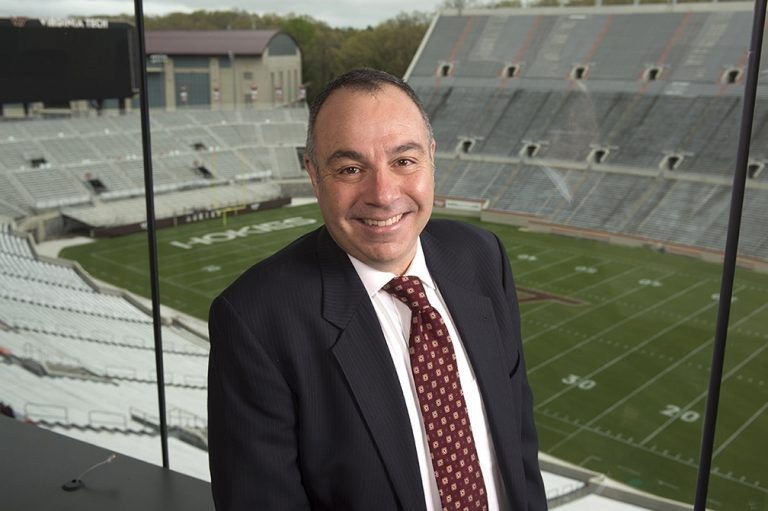 "For nearly three decades, Bill Roth served as the Voice of the Hokies, providing play-by-play coverage of Virginia Tech football and men's basketball. His jubilant call when Hokies crossed the end zone — ""Touchdown, Tech!"" — became iconic."