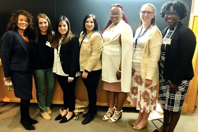 2019 Bouchet Graduate Honor Society scholars gather during the ceremony at Yale University. From left: Chontrese Doswell Hayes, one of the society'ss founders and a Virginia Tech alumna; Ashley Taylor; Mayra Artiles Fonseca; Ayesha Yousafzai; Racheida Lewis; Erika Bass; and Shernita Lee, Graduate School director of recruitment, diversity, and inclusion. Photo courtesy of Ashley Taylor.