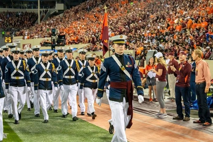 Cadet Brett Smith of the Virginia Tech Corps of Cadets leads Golf Company into Lane Stadium during the pregame ceremonies.