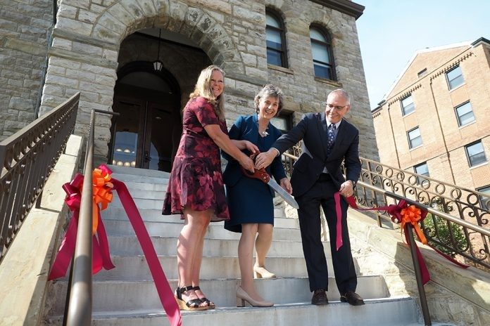 Dean Rosemary Blieszner (center) joined LaTawnya Burleson, president of the college's Staff Association, and Cyril Clarke, executive vice president and provost of Virginia Tech, in the official ribbon cutting for the college's new headquarters.