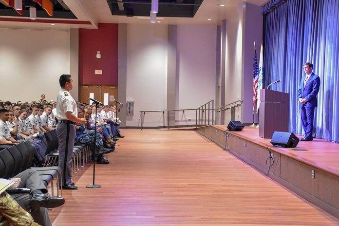 Cadet Matt Krusiac, at left, a senior majoring in history, asks Secretary of the U.S. Army Mark T. Esper a question during a town hall-style meeting with the Virginia Tech Corps of Cadets.