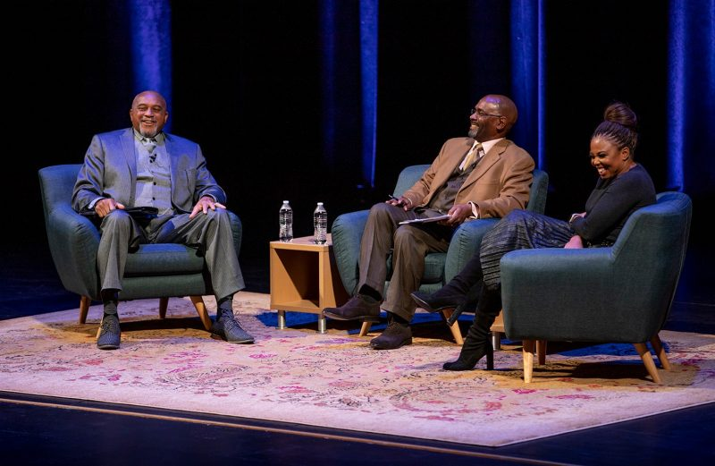 "Thomas ""Tommie"" Smith (left), Ellington Graves, and Jemele Hill speak on the stage of the Moss Arts Center during their conversation as part of Virginia Tech's 2019 Martin Luther King Jr. Celebration."