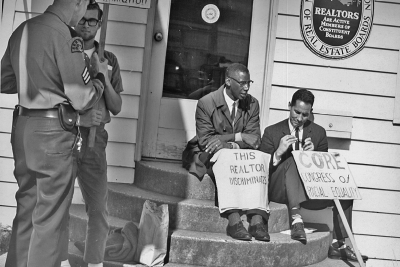 Participants gather for a fair housing protest in Seattle, Washington, in 1964.