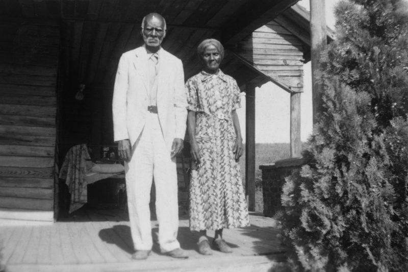 Anderson and Minerva Edwards stand together on a front porch