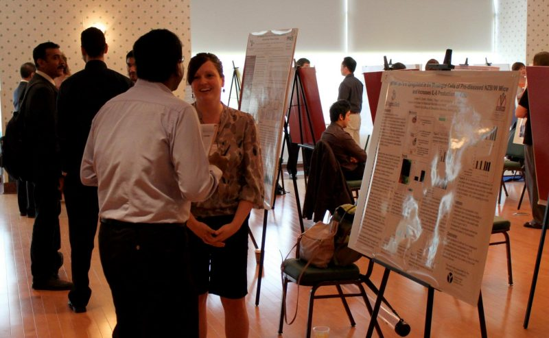 a woman with short hair and glasses participates in an online discussion