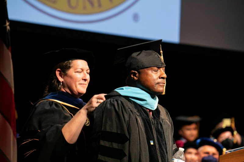 an image of a notebook with a pair of glasses set on top and an open pen