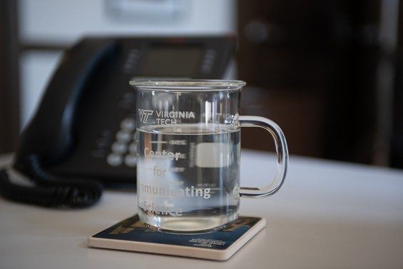 A Virginia Tech Center for Communicating Science drinking glass in the shape of a beaker