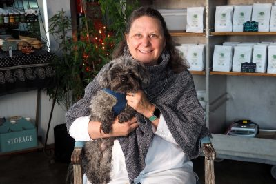 Deborah Custer sits in the Innovation Mill with Oliver, the namesake of a product she created to reduce anxiety in dogs and cats.