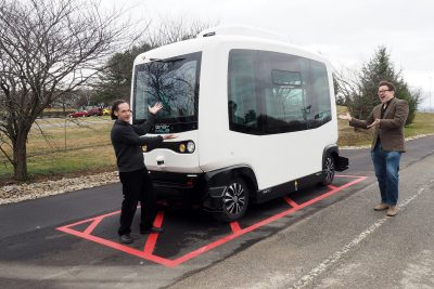 Saul Halfon (left) and Lee Vinsel playfully consider a low-speed autonomous shuttle undergoing testing at the Virginia Tech Transportation Institute. Halfon, an associate professor at Virginia Tech, explores public engagement with science and technology, while Vinsel, an assistant professor, studies the intersection of technology and humanity.