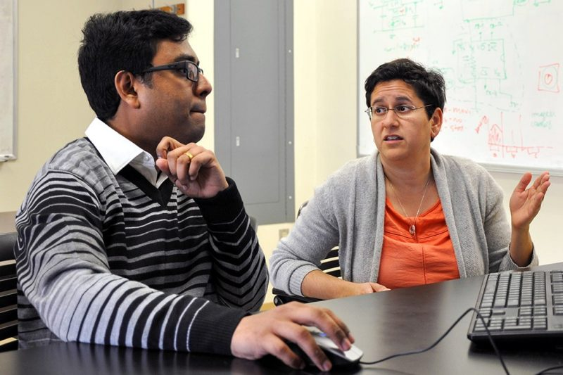 In the Complex Systems Laboratory at Virginia Tech, Subhradeep Roy (left) and Nicole Abaid discuss a mathematical formula used in computational modeling. Roy and Abaid analyzed extensive datasets to identify and rank important factors influencing opinions and public policy on same-sex marriage legislation in the United States. They also used their findings to build a predictive model of the law's adoption.