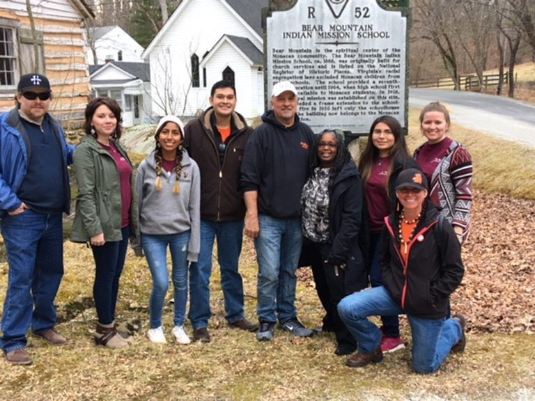 Virginia Tech students and faculty leaders visited the Monacan Nation in Amherst County recently to share information about the university experience with tribal youth. Pictured from left to right are Sam Cook, director of American Indian Studies; Melissa Faircloth, advisor of Native at VT; Lucia Chambi; Jason Chavez; Monacan Nation Chief Dean Branham; Menah Pratt-Clarke, vice provost for inclusion and diversity; Nizhoni Tallas; Qualla Ketchum; and Mae Hey, indigenous community liaison.