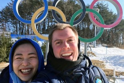 Harvey Creasey takes a selfie with Kayla, one of his Korean translators, in front of the famed Olympics logo.