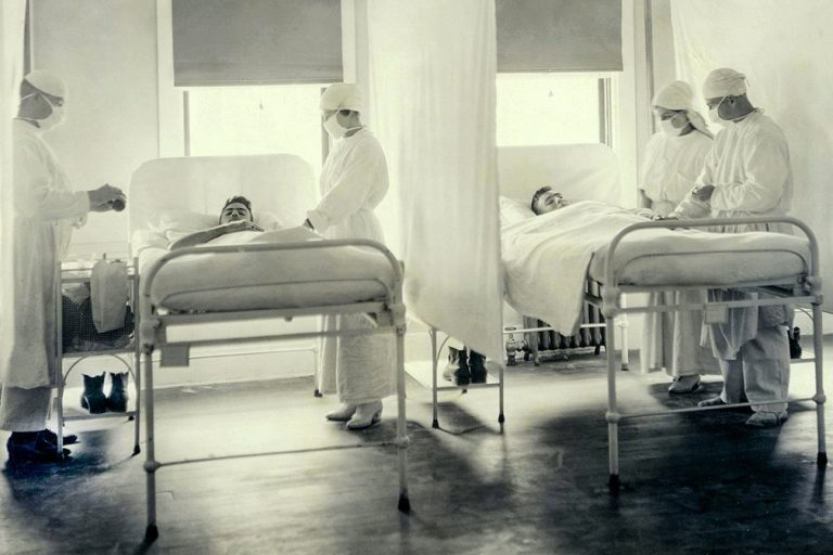Sailors receive treatment in the influenza ward at Mare Island Naval Base near San Francisco in November 1918. (Courtesy of U.S. Navy Medicine)