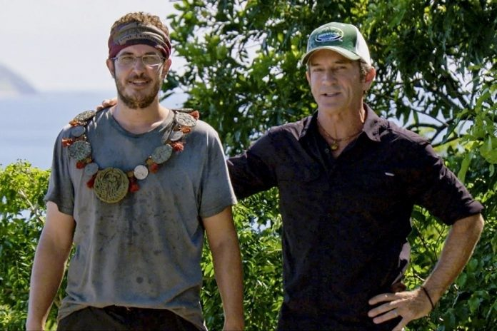 "Show host Jeff Probst awards Rick Devens with the Immunity Necklace during the 10th episode of ""Survivor: Edge of Extinction"" on the CBS Television Network. Photo: Screen Grab/CBS Entertainment ©2019 CBS Broadcasting Inc. All Rights Reserved."
