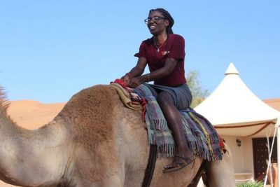 Katherine Louis rides a camel in Oman. Photo courtesy of Katherine Simko