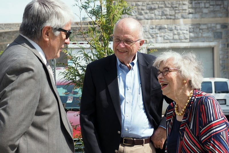 Brian Shabanowitz, the college's associate dean for finance and administration, talks with Janet Johnson, a former dean of the college, and her husband, Jim.