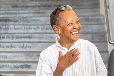 Internationally renowned poet Nikki Giovanni stands in front of 22 Steps, on ongoing Moss Arts Center installation that presents poetry as a spatial and visual experience unleashed from the confines of the printed page.