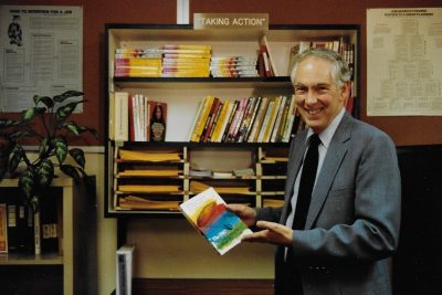 Carl McDaniels stands in his office, showing an example of a resource for career seekers. Photo courtesy of Diane McDaniels.