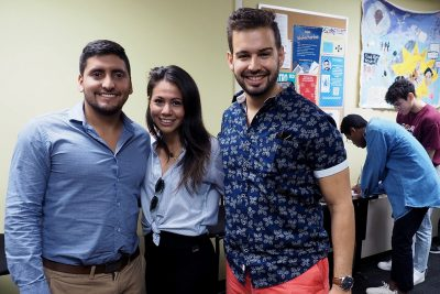 Students gather at an event at El Centro, the university's Hispanic and Latinx Cultural and Community Center. From left, graduate students Juan José Monsalve, Alejandra Rosado, and José Santiago-Rivera.