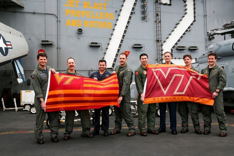 Hokie alumni deployed with the Carrier Strike Group 12 include, from left, Cmdr. Matthew Wright, Cmdr David Dartez, Lt. Cmdr. Anthony LaVopa, Lt. Nick Len, Lt. Tom Clapp, Aerographer's Mate 2nd Class Patrick Nichols, Lt. Joe Haslem, and Lt. Jonathan Bressette. Not pictured are Lt. Mondre Barnes and Lt. Tyler Manuel.