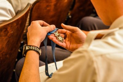 During a 2018 lecture, a cadet takes a close look at a Medal of Honor received by Leroy Petry, a retired U.S. Army master sergeant who received the medal for actions on May 26, 2008, in Paktya Province, Afghanistan.