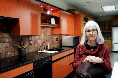 Kathleen Parrott stands in a kitchen