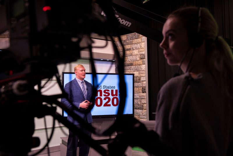 Andrew Webb does a news segment in the Department of Communication's broadcast studio in the Moss Arts Center.