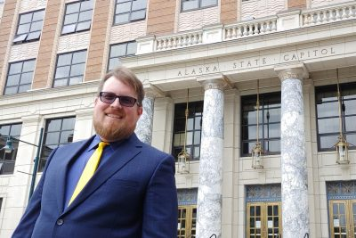 James Brooks stands in front of the Alaska State Capitol building in Juneau.