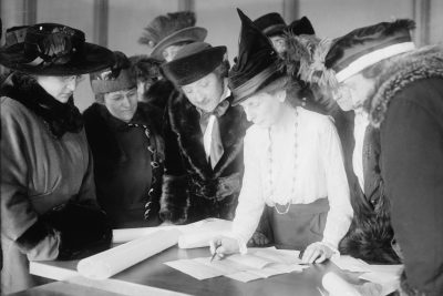 Suffragist Bertha M. Furman (center), who worked for the League of Women Voters, teaches women how to vote. Photo, taken circa 1915, courtesy of the George Grantham Bain Collection/Library of Congress.