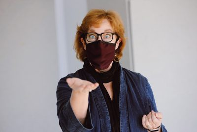 Patty Raun, a professor in the School of Performing Arts at Virginia Tech and director of the Center for Communicating Science, demonstrates ways to communicate behind a face mask.