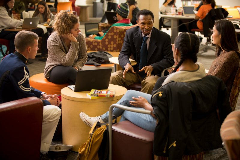 Sylvester Johnson with students seated in Newman Library